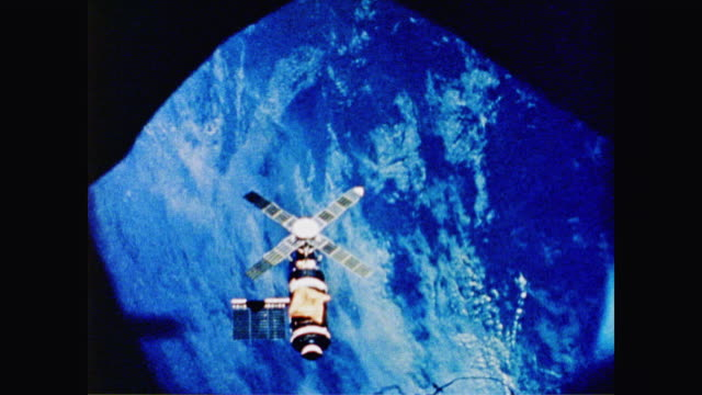 stockvideo's en b-roll-footage met skylab floats in space providing data on both space and the planet earth simultaneously - 1973