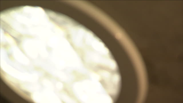 vídeos de stock e filmes b-roll de a skylight diffuses light in a bedroom ceiling. - claraboia