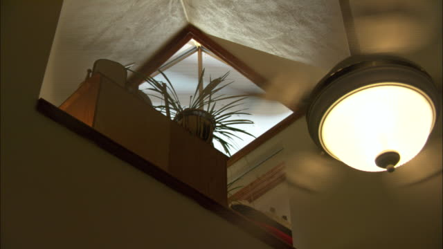 a skylight sunlight to enter a home. - ceiling fan stock videos & royalty-free footage
