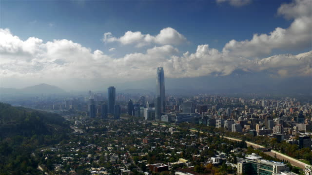 Skyline aerial view of Santiago de Chile with Costanera Tower and Andes Mountains