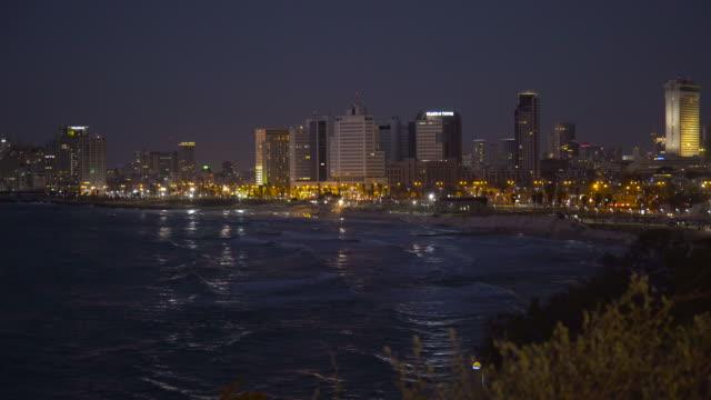 tel aviv: skyline and coastline of telaviv at night - tel aviv stock-videos und b-roll-filmmaterial