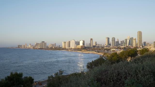 tel aviv: skyline and coastline of telaviv at the golden hour before sunset - jaffa stock-videos und b-roll-filmmaterial