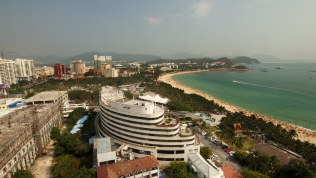 skyline and crowded beach in sanya, hainan province, china. view from above. wide shot. - spoonfilm stock-videos und b-roll-filmmaterial