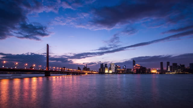 t/l ws skyline and modern buildings of hangzhou at riverbank at night, hangzhou,china. - hangzhou stock videos & royalty-free footage