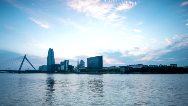 stockvideo's en b-roll-footage met skyline and modern buildings of ningbo at riverbank during dawn,time lapse. - ningbo