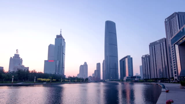 Skyline and modern buildings of tianjin at riverbank during sunrise,hyper lapse.