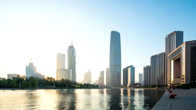skyline and modern buildings of tianjin at riverbank during sunrise,time lapse. - tianjin stock videos & royalty-free footage