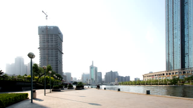 skyline and modern buildings of tianjin at riverbank,time lapse. - facade stock videos & royalty-free footage