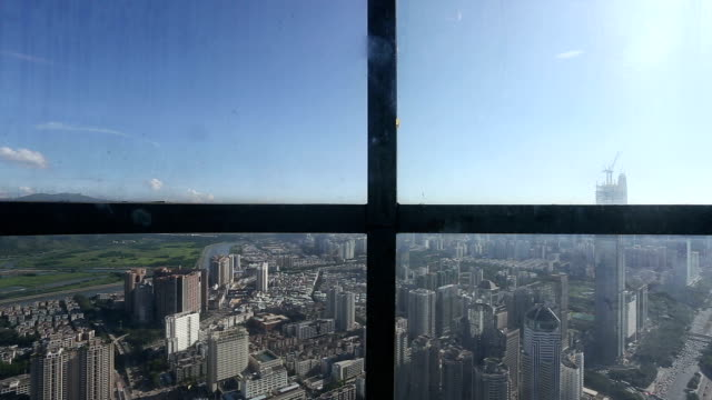 Skyline and modern office buildings in shenzhen,view from elevator,time lapse.