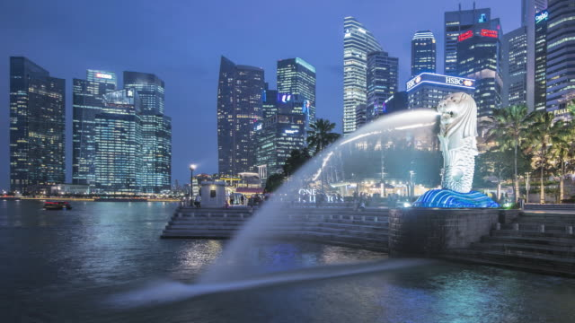 ws t/l skyline at dusk with merlion statue / singapore - animal representation stock videos & royalty-free footage
