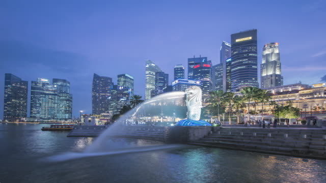 ws t/l skyline at dusk with merlion statue / singapore - merlion fictional character stock videos and b-roll footage