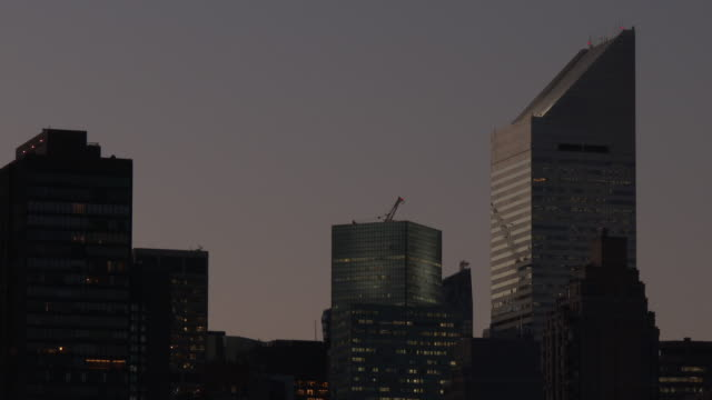 nyc skyline - citicorp building at dusk - citigroup center manhattan stock videos & royalty-free footage