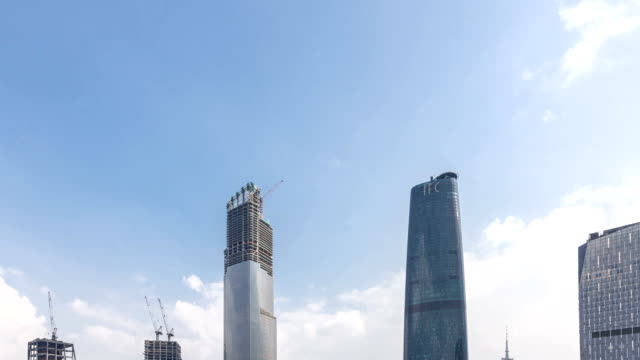 t/l ws td cbd skyline daytime / guangzhou, china - tilt down stock videos & royalty-free footage