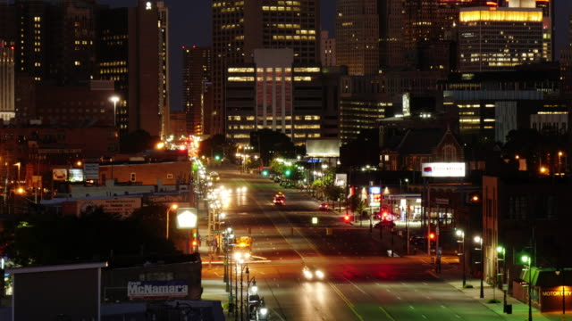 skyline detroit at night. tilt up from traffic on michigan ave. view from corktown. - spoonfilm stock-videos und b-roll-filmmaterial