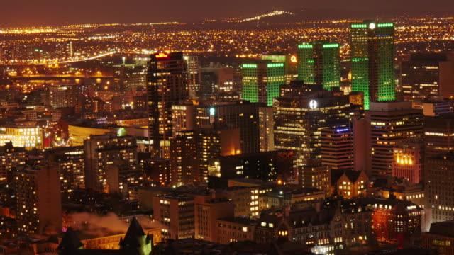 skyline downtown montreal at night time lapse – medium shot - vieux montréal stock-videos und b-roll-filmmaterial