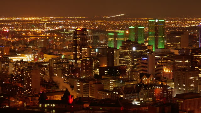 skyline downtown montreal at night time lapse – wide shot - vieux montréal stock-videos und b-roll-filmmaterial