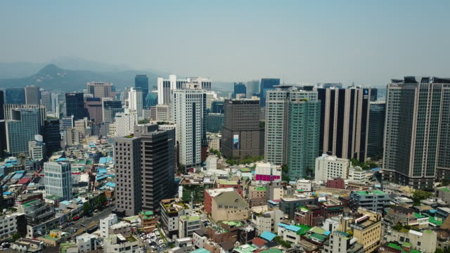 skyline in seoul - aerial view of south korean capital city - korea stock videos & royalty-free footage