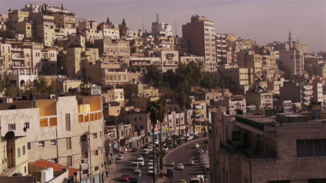 skyline of amman in jordan, middle east - campo totale video stock e b–roll