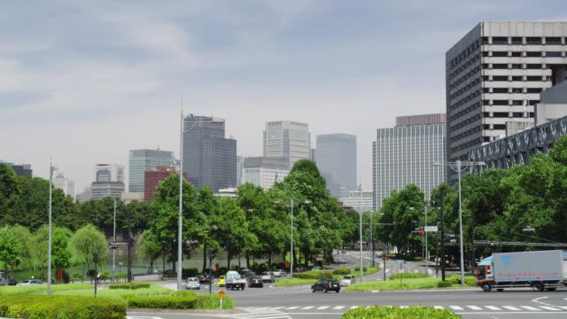 ws skyline of buildings in hibiya and uchisaiwai-cho / tokyo, tokyo-to, japan - street点の映像素材/bロール