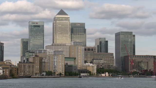 ms skyline of canary wharf business district with hovercraft on river thames in foreground / london, united kingdom - hovercraft stock videos & royalty-free footage