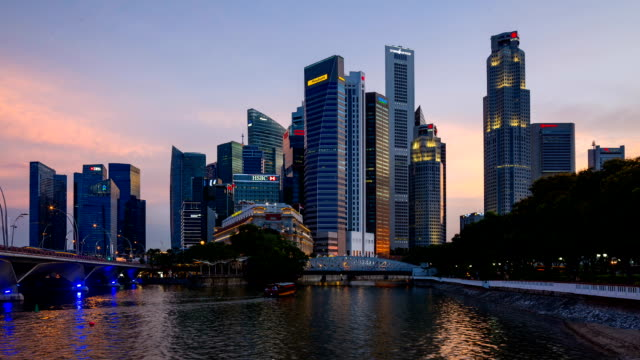 skyline of central business district in dusk - singapore river stock videos & royalty-free footage