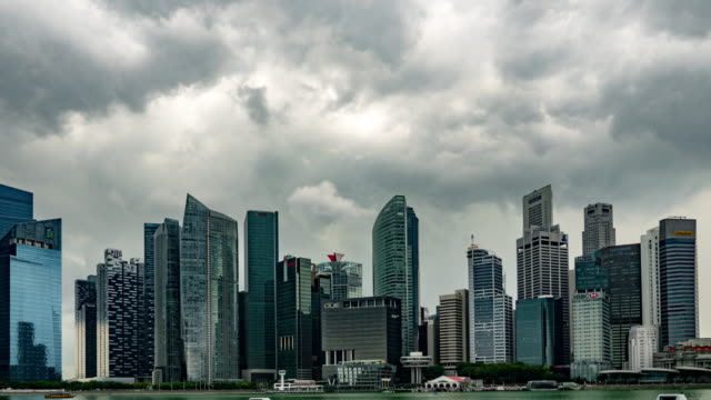 skyline of central business district of singapore city - storm cloud stock videos & royalty-free footage