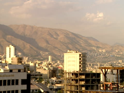 pan skyline of city with the alborz mountains in the distance / tehran, tehran, iran - letterbox format stock videos & royalty-free footage