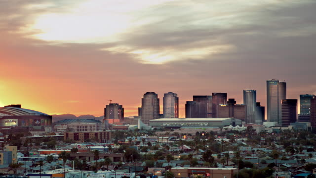 WS T/L Skyline of downtown Phoenix with Chase Field baseball stadium at dusk / Phoenix, Arizona, USA
