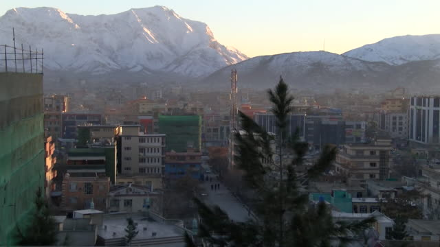 skyline of kabul city with snow covered mountains in background in afghanistan - kabul stock videos & royalty-free footage