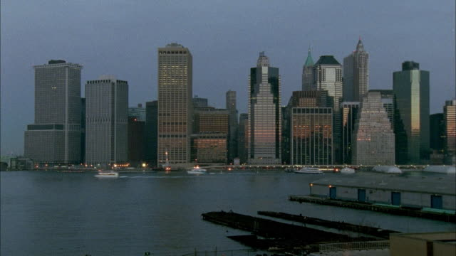 tl ws skyline of lower manhattan from dawn to day from across the hudson/ new york city - dawn to day stock videos & royalty-free footage