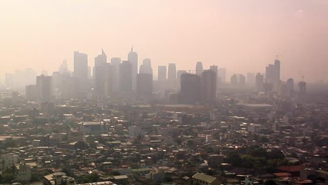 WS, HA, Skyline of Makati district in morning mist, Manila, Philippines
