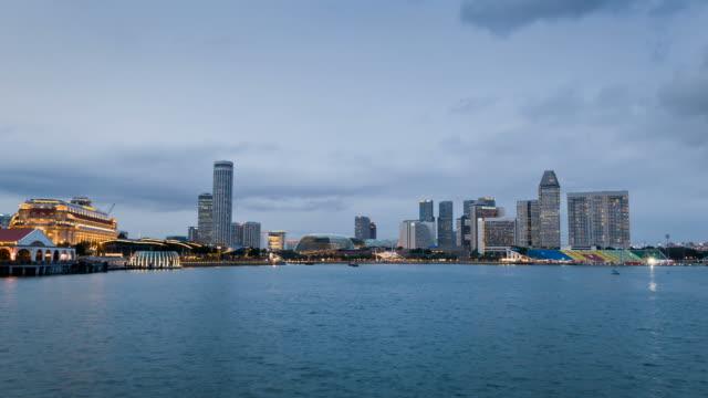 skyline of marina bay in dusk - raffles city stock videos & royalty-free footage
