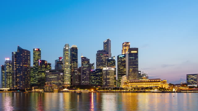 skyline of marina bay, singapore, day to night time lapse video - singapore stock videos & royalty-free footage