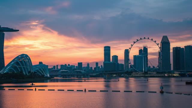 skyline of marina bay, singapore, day to night time lapse video - singapore river stock videos & royalty-free footage