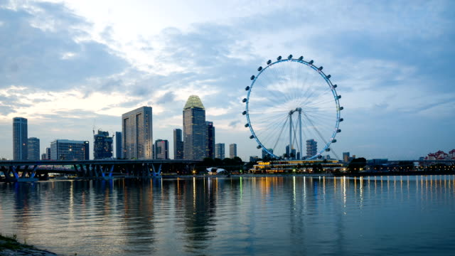 skyline of marina bay, singapore - singapore flyer stock videos and b-roll footage