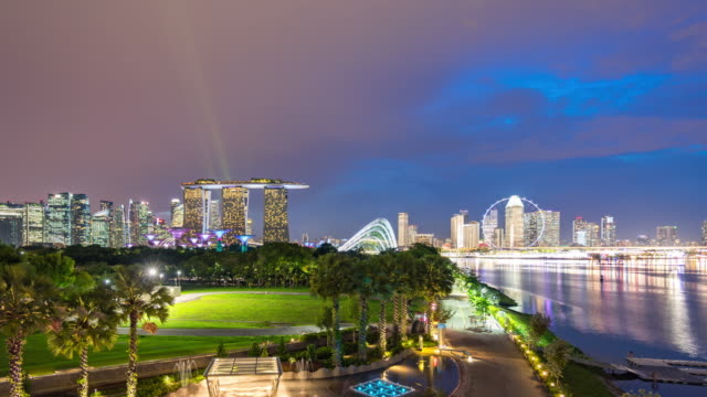skyline of singapore, day to night time lapse video - singapore river stock videos & royalty-free footage