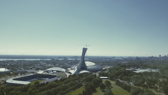skyline of the city and olympic stadium the big o - montréal stock videos & royalty-free footage