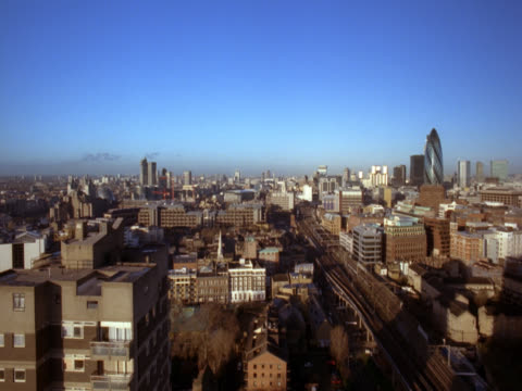 skyline on a sunny day looking south. busy roads and a train rushing from the distance towards the foreground. london, uk - londonalight stock videos and b-roll footage