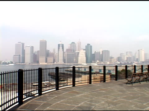 vs nyc skyline on foggy misty day from various locations southern tip manhattan pan from brooklyn bridge brooklyn heights promenade staten island... - promenade stock videos & royalty-free footage