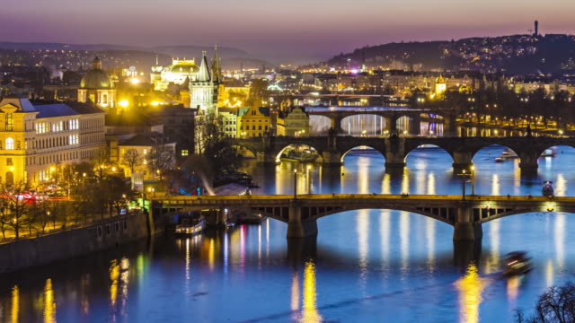 skyline prague with bridges at sunset, time lapse - czech culture stock videos & royalty-free footage