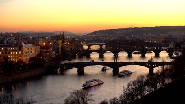 skyline prague with bridges at sunset - charles bridge stock videos & royalty-free footage