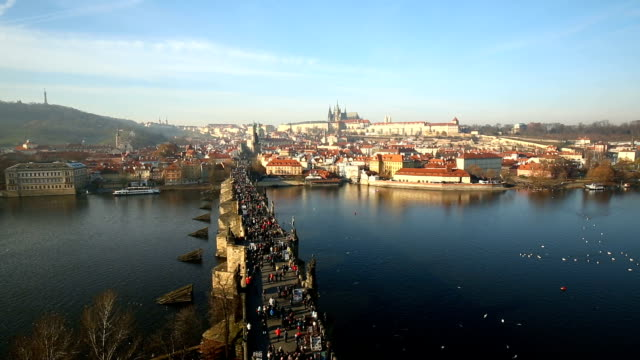 skyline prague with charles bridge - charles bridge stock videos and b-roll footage