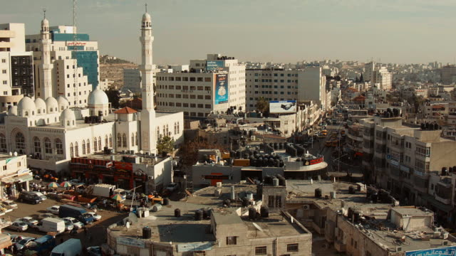 skyline ramallah with central mosque and traffic seen from above. - ramallah stock videos and b-roll footage