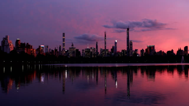 skyline reflections at dusk - central park reservoir stock videos and b-roll footage