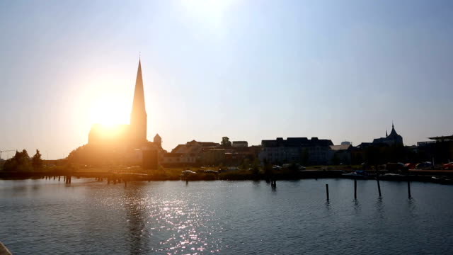 skyline rostock with sun - kirche stock videos and b-roll footage