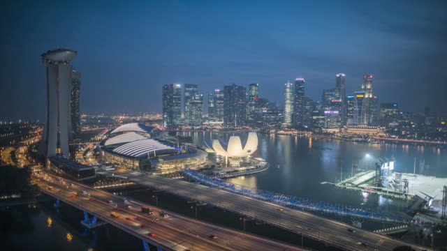 ws t/l td skyline shot from the flyer at dusk / singapore - singapore flyer stock videos and b-roll footage