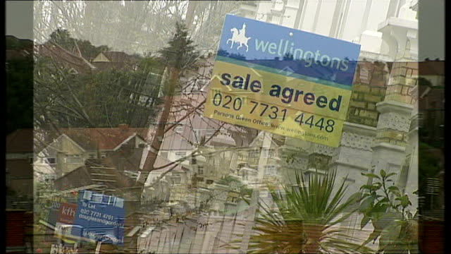 skyline showing rooftops of housing estate 'for sale' signs outside hosues northern rock branch and sign - banking sign stock videos & royalty-free footage