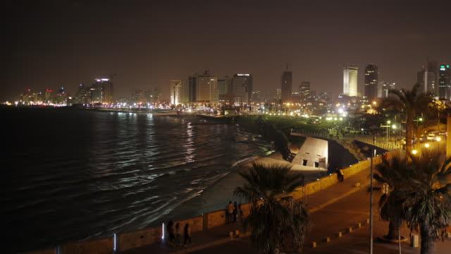 skyline tel aviv at night - time lapse - spoonfilm stock-videos und b-roll-filmmaterial