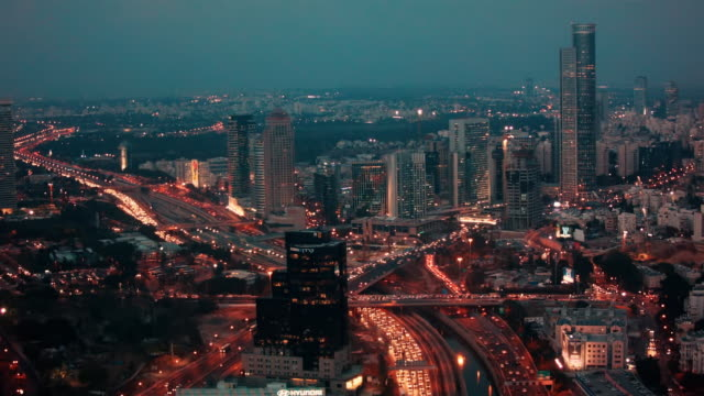 skyline tel aviv from dwn to night with busy rush hour traffic. - tel aviv stock-videos und b-roll-filmmaterial