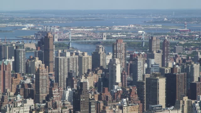 skyline views from a residential building of the upper west side upper east side midtown triboro bridge and queens from new york new york on... - markenname stock-videos und b-roll-filmmaterial